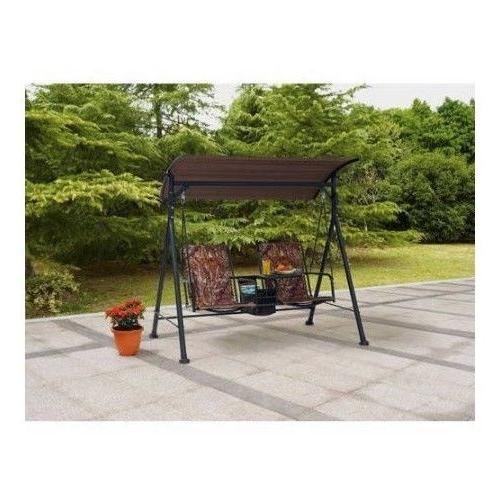 two seat swing with pivoting table porch